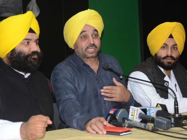 AAP MP Bhagwant Mann along with senior leader  Himmat Singh Shergill (left) and youth leader Harjot Singh Bains in Chandigarh.