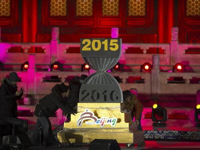 Workers push a 2016 countdown clock into position during a rehearsal for a New Year's Eve countdown celebration in Beijing. As the world gears up for a new year, security agencies across the world have sent out terror alerts in major cities from Europe to China.