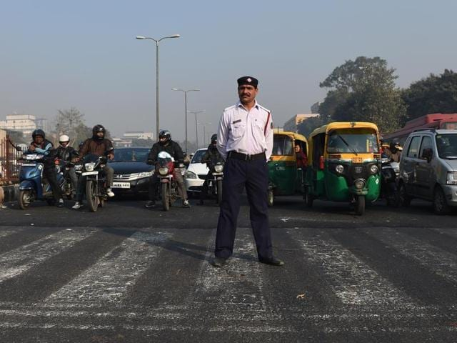 Commuters on motorbikes are seen at a traffic intersection in New Delhi on December 31, 2015. All eyes are on Delhi to see if it's new odd-even scheme will work.(AFP Photo)
