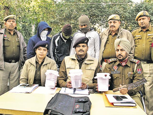 Police officials showing the currency recovered from the recovered in Jalandhar on Wednesday.