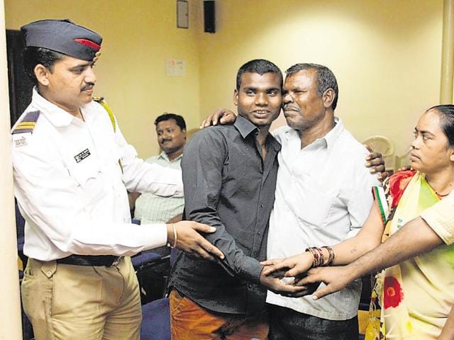 Traffic constable Namdev Himgiri with Lahu Ghogarkar (in grey shirt) after he was reunited with his family.