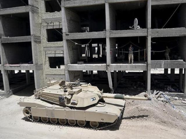 A tank of the Iraqi army is seen on the outskirts of the city of Falluja.