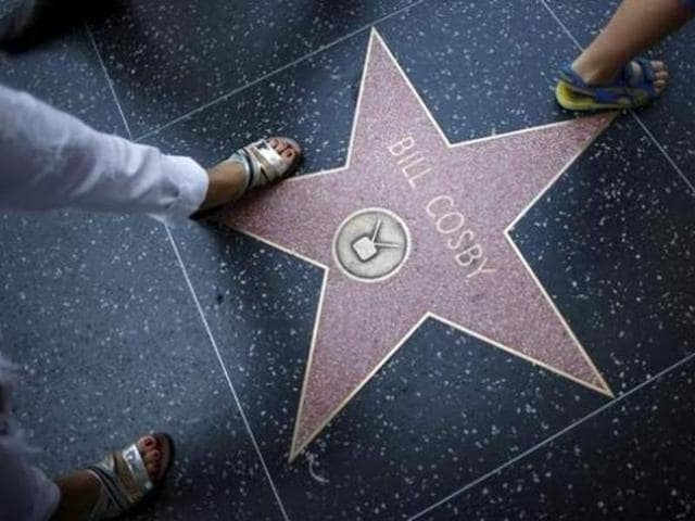 People walk over Bill Cosby's star of the Hollywood Walk of Fame in Los Angeles, California, United States July 9, 2015.