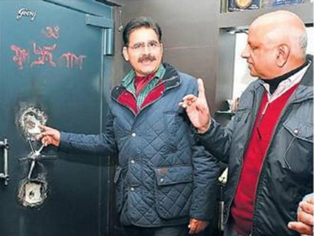 The jewellery shop owner showing a locker in Sangrur on Thursday. The stolen ornaments and cash was worth Rs25 lakh.