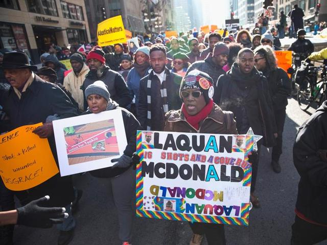 Demonstrators calling for an end to gun violence and the resignation of Chicago Mayor Rahm Emanuel march through downtown on December 31, 2015 in Chicago, Illinois.