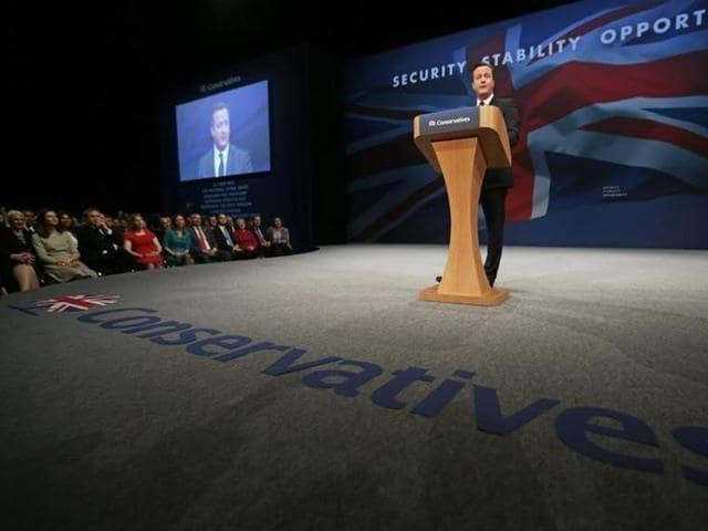 Britain's Prime Minister David Cameron delivers his keynote address at the annual Conservative Party Conference in Manchester. REUTERS
