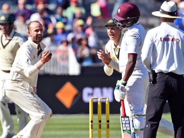 Australian spinner Nathan Lyon dives in an attempt to catch West Indies batsman Rajendra Chandrika on the second day of the second cricket Test in Melbourne.