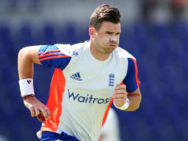 England's James Anderson celebrates taking the wicket of Pakistan's Shan Masood.