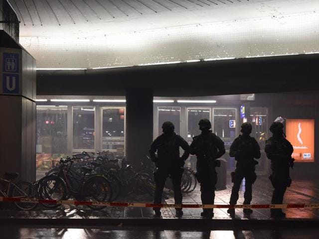 Police officers in riot gear are seen guarding the T