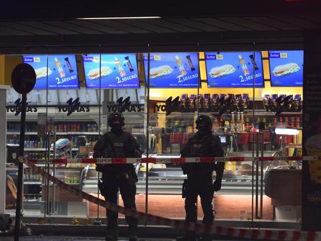 Police officers are seen guarding the entrance to the closed central station in Munich on January 1.