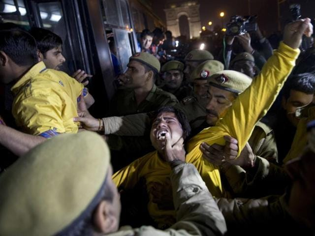 A man shouts slogans as he is detained by police during a protest against the release of a juvenile convicted in the fatal 2012 gang rape that shook the country in New Delhi, India.