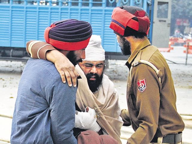 With no wheelchair available, cops had to pick up the accused Jagmohan Singh, who was produced before a magistrate in Jalandhar.