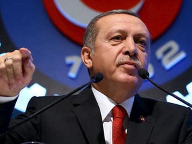 Turkey's President Tayyip Erdogan addresses the audience during a meeting in Ankara, Turkey.
