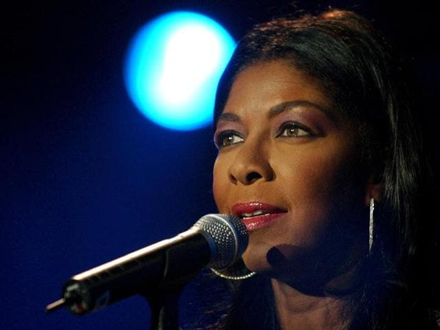 In a  2003 file photo, singer Natalie Cole performs on Stravinsky stage, during the 37th Montreux Jazz Festival, in Montreux, Switzerland.
