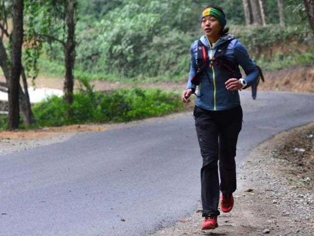December 15, 2015, Nepalese ultra runner Mira Rai gestures as she speaks before a training session in the hills surrounding Kathmandu, on December 15, 2015.