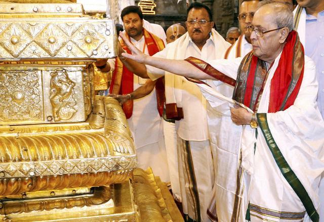 A file photo of President Pranab Mukherjee worshipping at sacred golden altar at Lord Venkateswara temple at Tirumala in Tirupati.