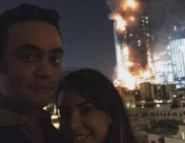 Twitter users have slammed a couple who took a selfie with the burning Dubai hotel in the background and posted it on social media
