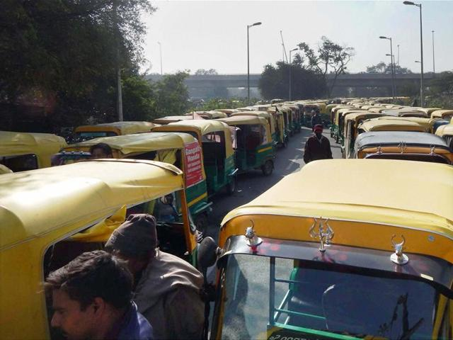 Auto-rickshaw drivers holding a protest against the misbehavior of police during Car Free Day in Gurgaon on Tuesday.