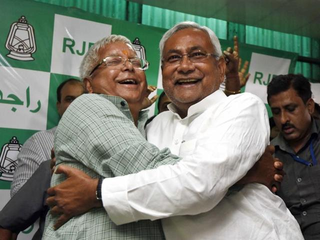 Bihar CMNitish Kumar and RJD supremo Lalu Prasad celebrate with a hug after winning Bihar elections. Lalu scoffed at the speculation regarding fissures between his party and JD(U) over killing of two engineers at Darbhanga and the alleged downslide in law and order situation.