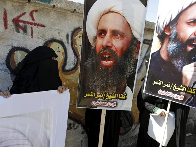 Shi'ite protesters carry posters of Sheikh Nimr al-Nimr during a demonstration outside the Saudi embassy in Sanaa in October 2014. Nimr al-Nimr, a driving force of protests that broke out in 2011 in the Sunni-ruled kingdom's east, was among 47 people executed in Saudi Arabia.