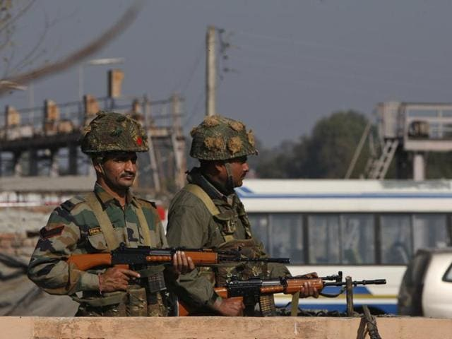 Soldiers take positions outside the Indian airbase in Pathankot that came under attack.
