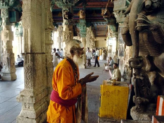 An Indian Hindu Sadhu (Holy man) prays at the Meenakshi Temple in Madurai, some 475 kms southwest of Chennai.