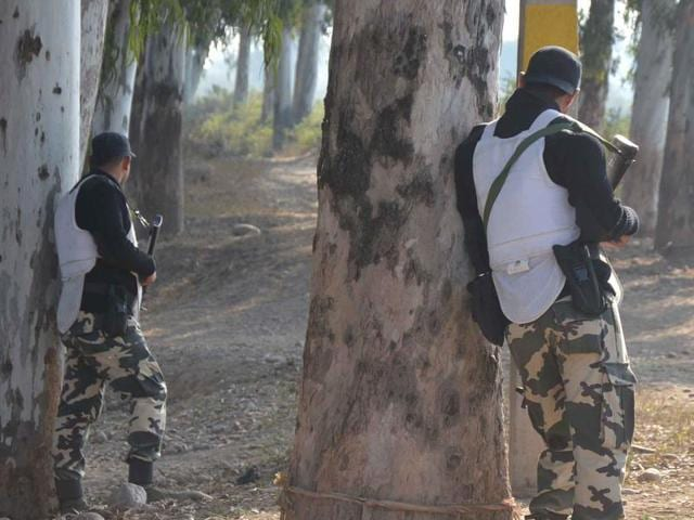 Punjab Police Swat Team security personnel guarding the road leading to Air Force base at Pathankot.