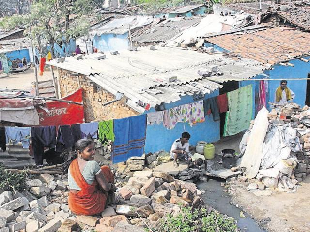 Residents of pooltoli slum at Kadrun in Ranchi go about their daily routine.