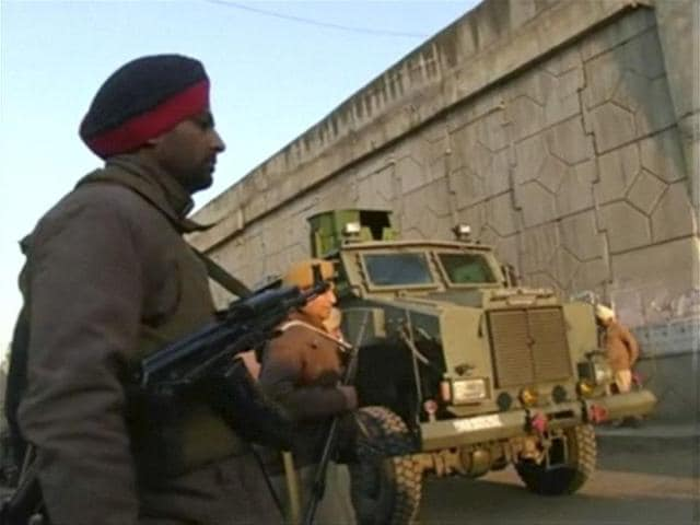 Police personnel stand guard following what officials said was an attack on an Indian Air Force base in Pathankot on Saturday near the border with Pakistan, in Pathankot.
