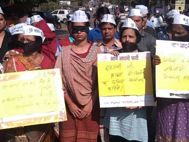 Aam Aadmi Party workers stage a demonstration against rising crimes against women in the state, in Bhopal on Sunday.
