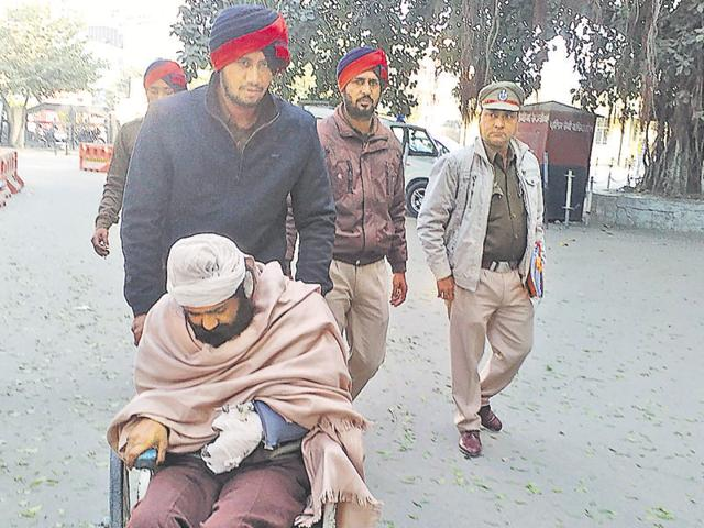 Cops taking car bomb blast accused Jagmohan Singh into the judicial complex on Sunday.