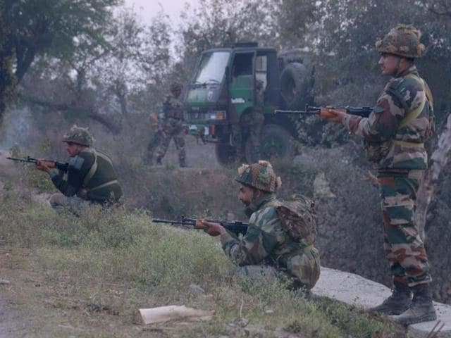 Indian Army personnel stand guard while on patrol near the Air Force base in Pathankot after the attack on Saturday.