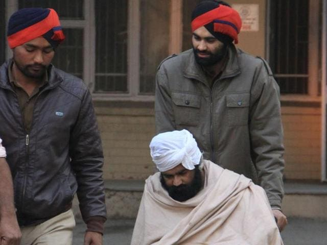 Car bomb blast prime accuse Jagmohan Singh being brought back from the court after hearing in Jalandhar on Saturday.