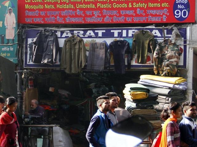 Despite ban, military dresses displayed outside different shops near railway station and selling without having any check on them in Ludhiana.