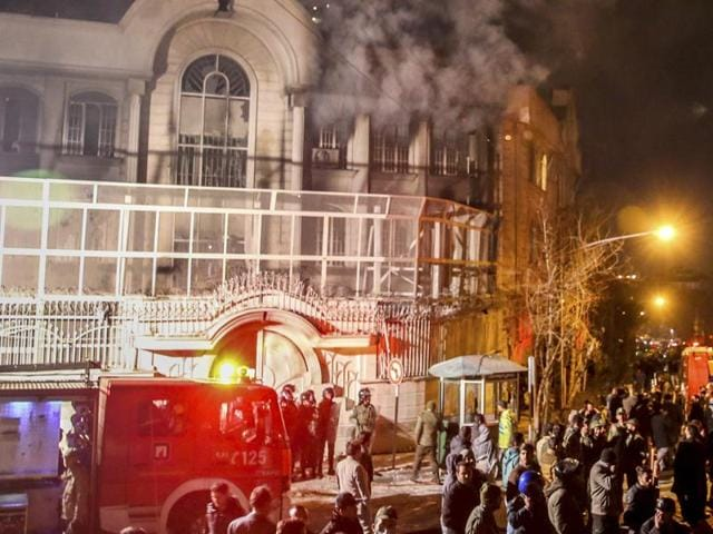 Smoke rises as Iranian protesters set fire to the Saudi embassy in Tehran. Protesters upset over the execution of a Shia cleric in Saudi Arabia set fire to the Saudi embassy in Tehran.