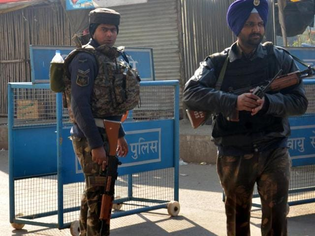 Security personeel guarding the road leading to air forcce station at Dhaki Chowk Pathankot. Saturday morning The terrorist had struck early saturday morning at the air force station. army at Pathankot on Sunday, January 03, 2016.