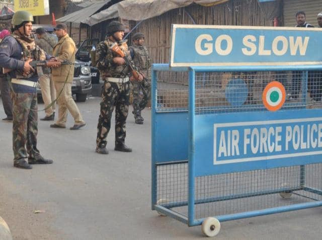 An Indian Air Force soldier takes up position outside Air force base in Pathankot.