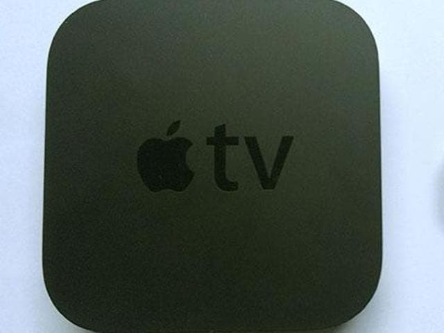 The Apple TV (right) costs four times as much as the Chromecast -- but it's totally worth it.