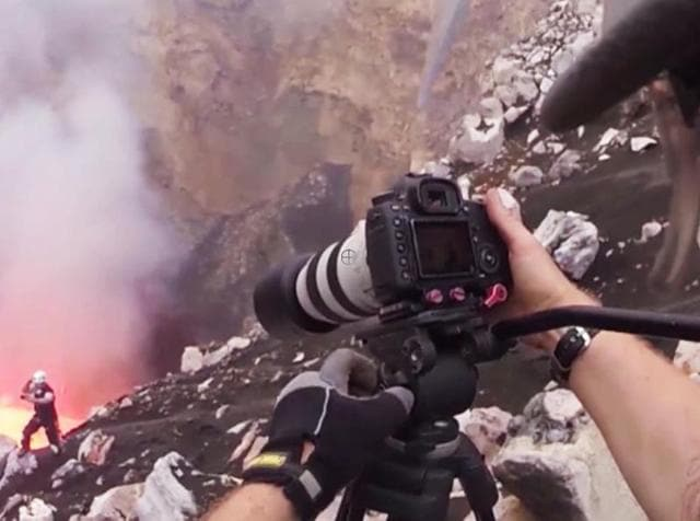 Despite the heat of the moment, one brave mountaineer kept his cool to take a selfie in front of an active volcano! Nik Halik, 45, from Los Angeles, USA, took the explosive shot while climbing the Benbow volcano on Ambrym Island, Vanuatu. But smiles aside, Nik's fellow climber Bradley Ambrose, 39, from Auckland, New Zealand, revealed that the risks of getting the shot were extremely high thanks to the staggering heat and toxic gases pumped out from the volcano. Nik and Bradley spent weeks waiting for the opportune moment to descend into the volcano's caldera and get close to Benbow's lava lake.