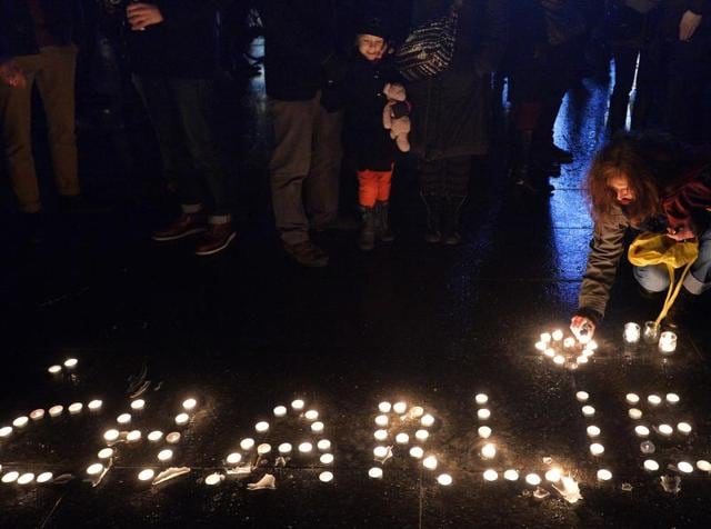 This file photo taken on January 07, 2015 shows people lighting candles forming the name Charlie during a gathering in Strasbourg, eastern France, following an attack by unknown gunmen on the offices of the satirical weekly Charlie Hebdo.