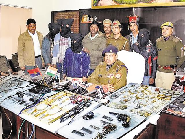 Police display the weapons they seized in Lucknow.