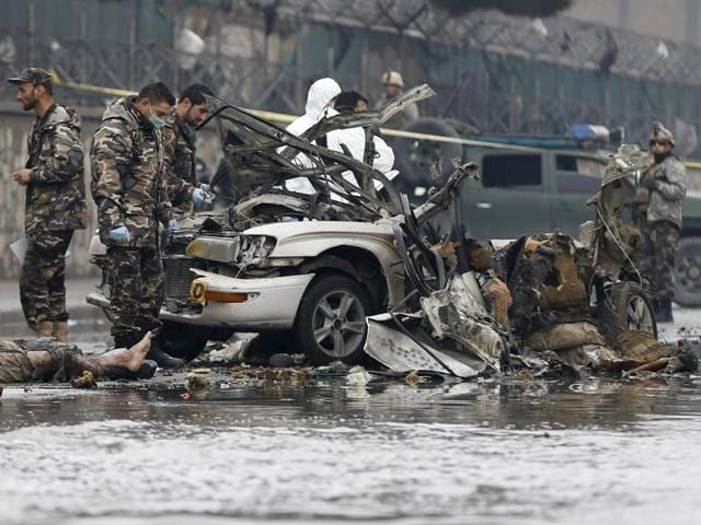 A member of an  investigation team holds defused explosives at the site of a suicide attack in Kabul, Afghanistan January 4, 2016. A suicide bomber in a car blew himself up close to a police checkpoint near Kabul airport on Monday but caused no other casualties, a police spokesman said.