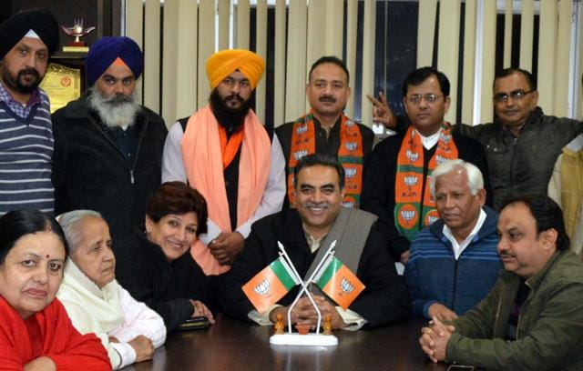 BJP city chief Sanjay Tandon with the candidates at the party office, Kamalam, in Sector 33 on Sunday.