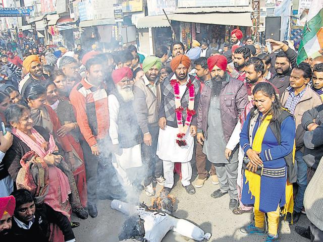 Congress workers burning an effigy of the SSP as they demanded his suspension, in Sangrur on Sunday.
