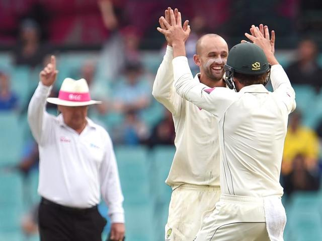Australian spinner Nathan Lyon sends down a delivery to the West Indies batsman on the first day of the third cricket Test match in Sydney.