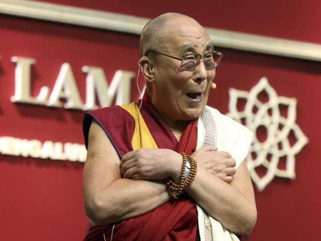 Tibetan spiritual leader, the Dalai Lama, laughs while interacting with the audience after delivering a speech in Bangalore. Chinese state media have accused Indian police of framing China by taking the Tibetan spiritual leader's claims that the country was planning to assassinate him seriously.