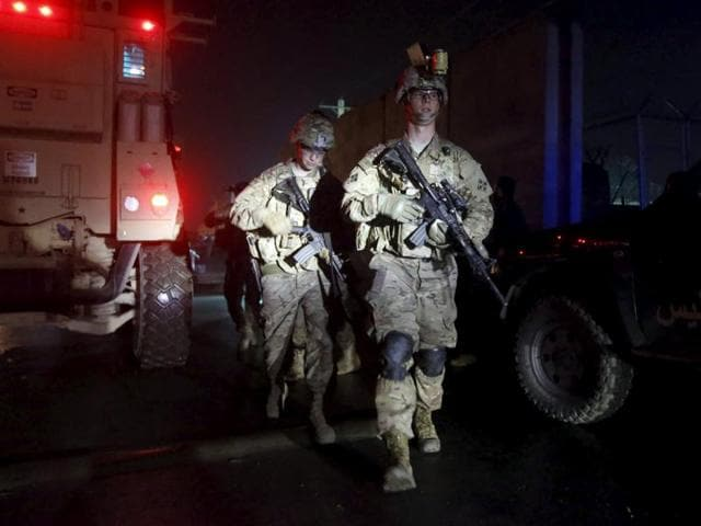 U.S. troops arrive at the site of an explosion in Kabul, Afghanistan January 4, 2016. A large explosion struck close to Kabul airport on Monday near to the area where a suicide bomber blew himself up earlier in the day in the latest in a series of attacks in the Afghan capital over the past week.