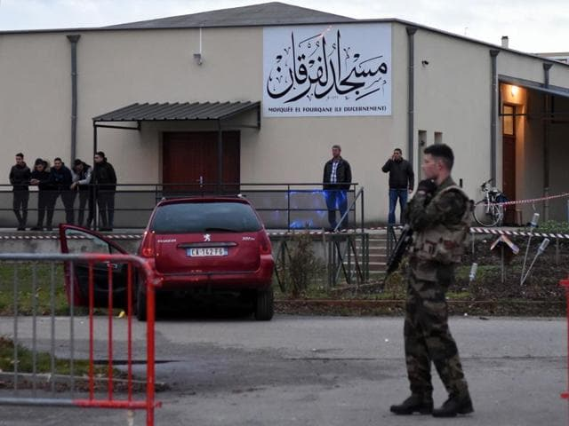 A car is pictured in front of the mosque of Valence, southeastern France, on January 1, 2016, after a soldier guarding the mosque shot and wounded a driver who rammed him with the car. The driver has not been charged with terrorism, though he is still under investigation on charges of attempted manslaughter.
