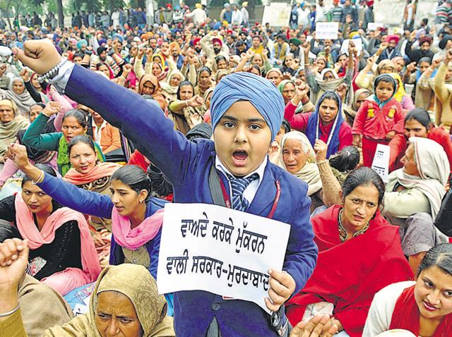 Family members of unemployed linemen protesting against the state government in Patiala on Monday.