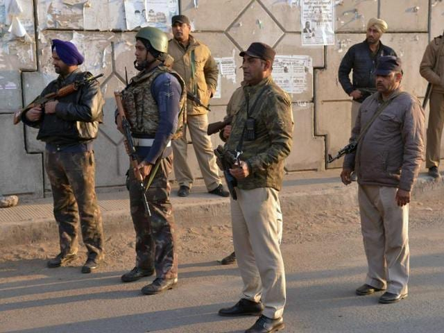 Indian security personnel stand alert on a road leading to an airforce base in Pathankot on January 3, 2016, during an operation to 'sanitise' the base following an attack by gunmen.